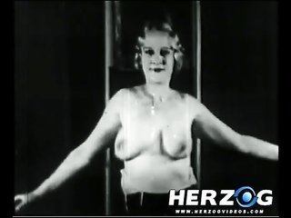 green light-haired makes a slip off clothes scene in 20s porn film