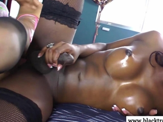 ebon lady-man inserts tool in asian ass