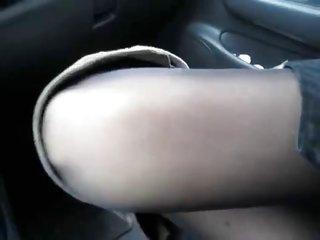 scanty e stivali in auto